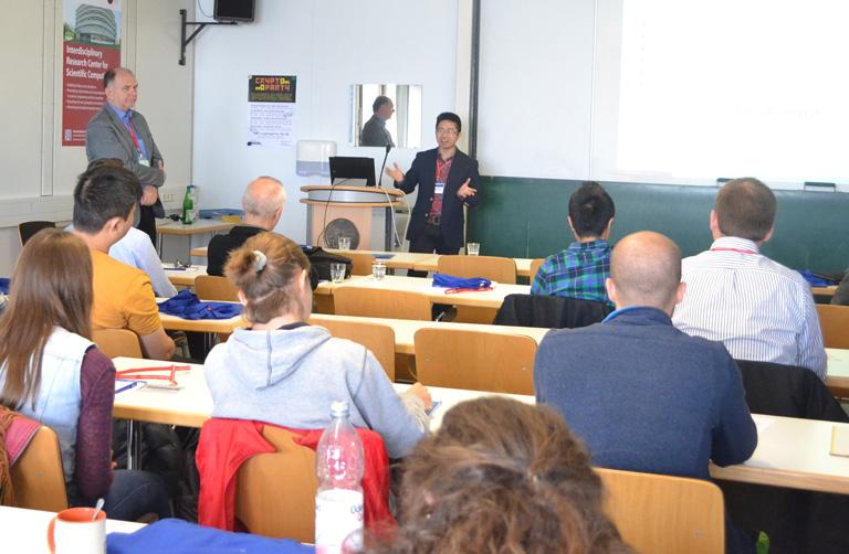 Tiến sỹ Nam báo cáo tại Hội nghị do mình tổ chức tại đại học Heidelberg